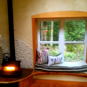 Wood stove and window seat. Booya!