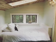 Comfy single bed with natural light from skylight